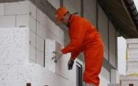 Praca Niemcy przy docieplaniach na budowie – Dortmund